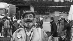 His best smile (Frank Fullard) Tags: frankfullard fullard candid street portrait horsefair horse fair ballinasloe mohill arigna ballyfarnon galway leitrim roscommon cap beard smile teasing tease fun laugh irish ireland character happy face xpression monochrome blackandwhite blanc noir