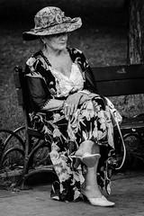 IMG_5653 (melnikov.photos) Tags: portrait bw blackandwhite monochrome street candid woman old alone sitting bench city fancy hat dress