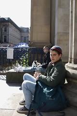 boy turns to camera glasgow (iamthecandleman) Tags: portrait boy man glasgow sit outside tourist hat bag water look happy scowl growl