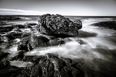 this rock within the sea (Port View) Tags: fujixe3 scotsbay novascotia ns canada cans2s 2018 summer morning tide tidal water movement motion waves swirling rock rocky bay coast shore coastal fundy bayoffundy blackandwhite bw monochrome mono longexposure le landscape seascape sky clouds laowa9mm