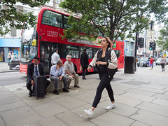 Oxford Street. 20180815T13-01-24Z (fitzrovialitter) Tags: peterfoster fitzrovialitter city camden westminster streets rubbish litter dumping flytipping trash garbage urban street environment london fitzrovia streetphotography documentary authenticstreet reportage photojournalism editorial captureone olympusem1markii mzuiko 1240mmpro microfourthirds mft m43 μ43 μft geotagged oitrack exiftool girl candid portrait streetportrait