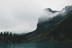 Mountain mist (photographybyjoss) Tags: mood dark mountains mountainsandmist canoneos5dmarkiii canada morainelake alberta banffnationalpark mountainside mountain landscape mist water forest banff national park