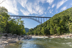 New River Gorge Bridge over the New River (Chuck - PhotosbyMCH.com) Tags: photosbymch landscape newrivergorgebridge newrivergorge newriver nationalpark fayetteville fayettestation westvirginia usa 2017 canon 5dmkiv river rocks rapids trees nature travel summer outdoors clouds