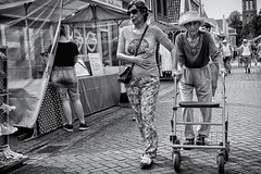 Come On, Let's Make Some Speed! (Alfred Grupstra) Tags: people blackandwhite street men cultures urbanscene shopping outdoors editorial store market walking women city famousplace senioradult retail travel tourism citylife