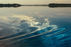 Stirring it up... (deanspic) Tags: paddleon wake reflection cpl g3x hooplebay longsault ontario stlawrenceriver boat canoe sun clouds ripples water light reflections cyan blue shades shadesofblue