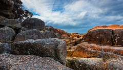 Come on baby light my fire.. (jenni 101) Tags: boulders lichen redrocks australia bayoffires tasmania