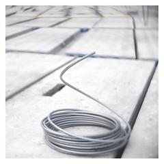 The art of snake charming (leo.roos) Tags: buildingsite bouwterrein tube flexible grey gray grijs hugomeyerkinonsuperiorif5cm meyerkinonsuperiori5016 projectorlens projectionlens focusinghelicoidtrioplan10028 exakta darosa leoroos