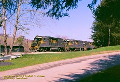 (SEE & HEAR)---P&LE 2027, Waynesburg, PA. 4-18-1990 (jackdk) Tags: train railroad railway locomotive emd emdgp38 emdgp382 gp38 gp382 ple pittsburghandlakeerie mga monongahela monongahelarailway coal coaltrain coaldrag waynesburg waynesburgpa standardcab fallenflag seeandhear seehear