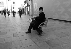 monoman (Andy WXx2009) Tags: streetphotography candid cardiff people urban man sitting shopping street fashion europe wales hat monochrome blackandwhite sidewalk outdoors bench city coat pavement profile