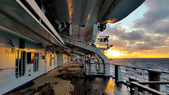 Sunrise in South Pacific (missgeok) Tags: sunrise southpacific cruiseship carnivalspirit morning sky clouds earlymorning deck steelstructures ocean water warmcolors moody heavyclouds railings weather sunny cloudy reflections colours windows composition