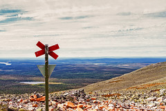 Cross On Top Of The Mountain (k009034) Tags: clouds copyspace cross finland fjell forest gravel harsh lake landscape lapland midsummer mold mountain nature nopeople north outdoors pile pole rock scene sign sky slope summer tranquilscene travel traveldestinations triangle wooden ylläs