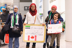 Refugees: Welcoming refugees at airport (The Presbyterian Church in Canada) Tags: editorial sponsor middleeast themedia civilrights syrianculture newsevent customs arrival emigrationandimmigration immigrant refugee arrivaldepartureboard waiting canadianculture war people syria toronto canada station airport airplane yyz torontoairport pearsoninternationalairport