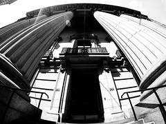 BMO Banque de Montreal (MassiveKontent) Tags: streetphotography montreal bw contrast city monochrome urban blackandwhite street photo montréal quebec photography bwphotography streetshot architecture asphalt concrete shadows noiretblanc blancoynegro gppro bank pillars oldmontreal columns fisheye