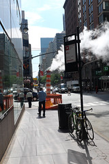 Towards the steam funnel (kevin Akerman) Tags: steam funnel man bikes street new york