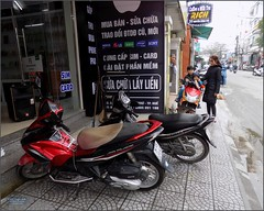 Vietnam, Hue City Bikes 20180213_093452 DSCN3166 (CanadaGood) Tags: asia asean seasia vietnam vietnamese hue building people person shopping honda yamaha motorcycle scooter parking advertising sign canadagood 2018 thisdecade color colour