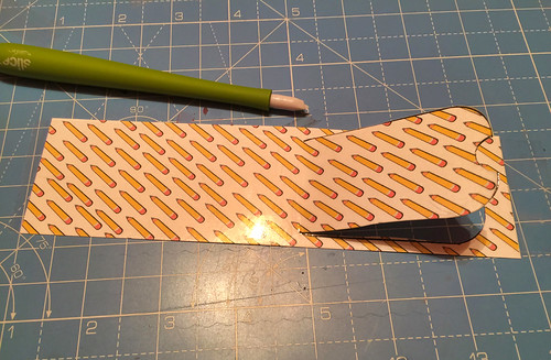 flip up cutting for backpack tags