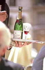 img030 (Phytophot) Tags: smileonsaturday deuxmagots cafe rivegauche champagne holding