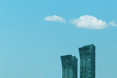 two buildings, two clouds and one plane (Marc McDermott) Tags: building flickr friday clouds toronto ontario canada architecture sky plane curve lines minimalism minimal urban city flickrfriday
