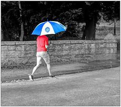 Red, white and blue (bob the bolder) Tags: uk durham prebends bridge man umbrella shorts red white blue