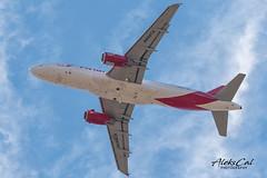 Avianca A320-233 N494TA (aleks_cal) Tags: sjo avianca cr costarica airbus takeoff airport a320 airbus320 red blue gearup