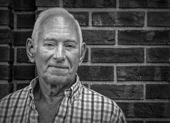 Street Portrait Project...... (Kevin Povenz Thanks for all the views and comments) Tags: 2018 june kevinpovenz westmichigan michigan holland hollandstreetperformers street streetphotography streetportrait male man brickwall shirt canon7dmarkii sigma24105art evening
