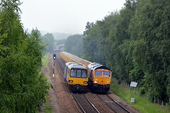 144001 & 66777 passing east of Mexborough station, 31st May 2018. (Dave Wragg) Tags: 144001 class144 pacer northern dmu railcar 66777 class66 gbrf 6e42 2r52 networkrail loco locomotive railway olddenaby