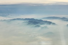 of giants and shadows (Jaws300) Tags: weather windowseat seat window airborne fromabove scenery flying flyingscenery nature hazy haze misty mist hills hill mountains mountain taipei taiwan