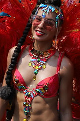Toned (Chuck Diesel) Tags: caribana2018 costume masquerader caribbeancarnival toronto parade people portrait fitness fit abs inshape smile ponytail hairextentions sunglasses