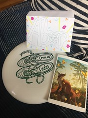 a disk and a card, perfect bday pressies from Glenn (olive witch) Tags: 2018 abeerhoque day frisbee handwriting indoors may may18 nyc