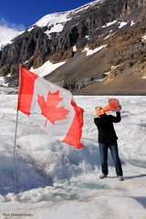 Trumpeteer & Canadian Flag on the Athabasca Glacier, Columbia Icefield, Icefields Parkway, Alberta,Canada (Black Diamond Images) Tags: athabascaglacier columbiaicefield jaspernationalpark glacier icefieldsparkway alberta canada scenictours scenic 2012 mountains mountain ice banfftojasper landscape sky snow mountainside canadianflag flag trumpeteer travelalberta albertatravel albertaholiday holidayalberta