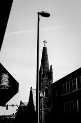 Light from above (RansomedNBlood) Tags: nikonf charleston street eastman2366 blackwhite bw 35mm wv westvirginia church steeple streetlight