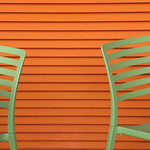 Green chairs and orange wall *explored* thumbnail