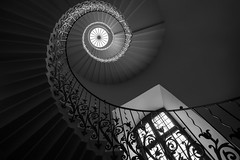 Spiraling Up. (5PR1NK5 • Vast Spaces & Forgotten Places) Tags: architecture staircase stairs stairporn spiral bw window arch light mood moody london tulip manor house stately home royal queens interior real estate dark pov fine art photography 5pr1nk5 mono canon mondays monomondays sprinks