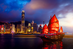 Hong Kong City skyline with tourist sailboat at night. View from across Victoria Harbor Hong Kong. (MongkolChuewong) Tags: architecture asia background beautiful beauty blue boat building business china chinese city cityscape cruise downtown harbor harbour hong hongkong island junk kong landmark landscape modern night ocean port red sailboat sea ship sightseeing sky skyline skyscraper sunset tour tourism tourist tower traditional transportation travel vacation vessel victoria view water wooden
