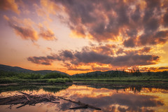 Fire in the sky (Yves Gauvreau) Tags: landscape sunset pond world100f