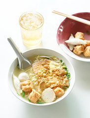 Fish ball noodles. A top view of fish ball egg noodles soup on the table served with ice tea. Window light. (enchanted.fairy) Tags: asia asian background ball balls bowl china chinese chopstick chopsticks cuisine delicious dinner dish eat fish food fresh gourmet green healthy hot isolated laksa lunch meal meat noodle noodles onion oriental pasta photograph plain pork pottery restaurant rice sauce simple simplicity soup tasty thai traditional vegetable vietnam vietnamese white yellow