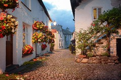 Wordsworth Street, Hawkshead (vesna1962) Tags: street cobbled narrow old cottages whitewashed flowerbaskets summer dusk streetlights williamwordsworth village hawkshead lakedistrict cumbria england