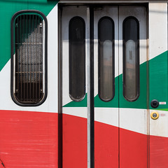 Trenino Italiano. Dettaglio. Small local Italian train. Detail. (sandroraffini) Tags: trenino littorina diesel train local regionale locale small railway station vivid colors italiano italian flag red green white bianco rosso verde entrata porte doors entrance abstract reality summer estate crespellano rural industrial hinterland paese village exploration reflections riflessi geometry geometria linee curve frammenti ritagli fragments canon eos80d 70200 sandroraffini minimalismo minimalism