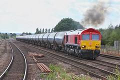 Working Hard (JohnGreyTurner) Tags: br rail uk railway train transport diesel engine locomotive barnetby lincs lincolnshire station ews db dbs dbc freight tanks 66 class66 shed