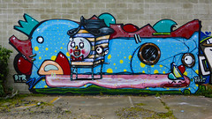 The Duck and the Beehive (Steve Taylor (Photography)) Tags: beehive duck staple jacobyikes dtr ladder porthole face bowtie eye hat graffiti mural streetart carpark blue red yellow pink mauve green fun cool newzealand nz southisland canterbury christchurch cbd city spot polkadots