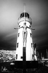 Diving Belle, Scarborough Harbour (Scotty Rae) Tags: lighthouse statue scarboroughbelle scarborough yorkshire infrared ir bw blackwhite monochrome belle woman diving light