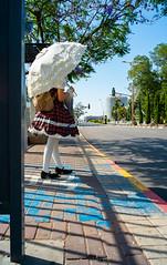 Waiting for the Stagecoach (Valentine Kleyner) Tags: israel street voigtlander heliar fuji xe1 girl