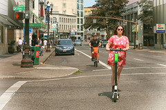 Leading The Way (Ian Sane) Tags: ian sane images leadingtheway electric scooter share bicycle southwest broadway stark candid street photography downtown portland oregon woman pink dress sunglasses bike lane canon eos 5ds r camera ef50mm f14 usm lens fixed