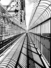 Jacques Cartier Bridge Walkway 2 (MassiveKontent) Tags: bridge jacquescartier streetphotography montreal bw contrast city monochrome urban blackandwhite street photo montréal quebec photography bwphotography streetshot architecture asphalt concrete shadows noiretblanc blancoynegro lines