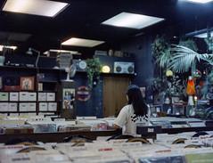Record Shopping (Blurmageddon) Tags: mediumformat filmphotography bronicaetrsi 75mmf28 cinestill800t epsonv700 downtownlosangeles nightphotography unicoloruniroller unicolorc41 homedeveleped