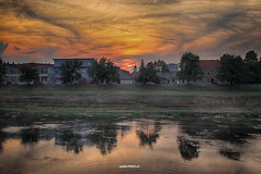 Across the river Kupa, Banija (malioli) Tags: sun sunset dusk sundow sky clouds golden hdr river water reflection buildings street urban city town karlovac kupa croatia hrvatska europe canon tree