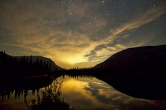 Clouds and Light Pollution (John Andersen (JPAndersen images)) Tags: alberta andromeda borderfx forest highway66 kananaskis kananaskislake mars milkyway moonless mountains nightlake perseid reflections saturn shoreline summer