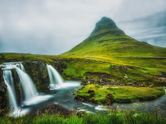 Kirkjufell, Iceland (S.A.W. Pixels) Tags: artistic amazing arts canon art iceland dramatic dark darkclouds drama excellent exposure exciting explore explored exposed flickr greatphotographers interesting impressive landscape landscapes outdoor observing outside overcast picture panaromic photo syedaliwarda sky mountain ocean water waterfalls rock waterfall grass kirkjufell moutain west people