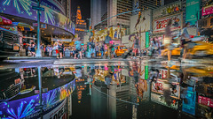 Reflections in New York City - Times Square. (danmiami) Tags: action beautiful buildings cars city cityscape color commercial landscape lights neon newyork newyorkcity outdoor people reflections signs sky skyline street taxi reflection