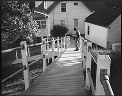 photographer David Aimone at work, late light, lighthouse complex, Owl's Head, Maine, Koni Omega Rapid 100, Super Omegon 90mm f-3.5, Arista.Edu 200, Ilford Ilfosol 3 developer, 7.18.18 (steve aimone) Tags: davidaimone photographer architecture ramp lighthouse owlshead owlsheadlighthouse maine koniomegarapid100 superomegon90mmf35 kodaktmax400 ilfordilfosol3developer 6x7 mediumformat monochrome monochromatic blackandwhite 120 120film film primelens